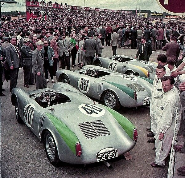 Porsche 550 Spyders - 1954 Le Mans 24 hr. The huge crowd is standing on the pit straight at Le Mans on June 12, 1954 before the start of the 24 Hour race. The cars are all Porsche 550 official works-entered spyders. This was the second year for Porsche 550 sports-racers at Le Mans and continued their prior year's success of winning the 1500 cc sports class.