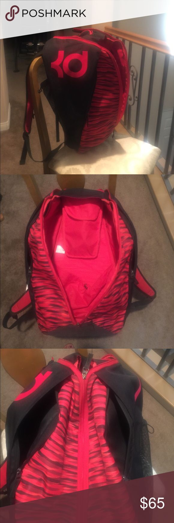Backpack🎒 Red Nike Kd basketball🏀 backpack. With thermal compartment, two compartments on inside. Water bottle pockets on each side. 2 zipper pockets in front also. In last picture shows where my son had his name but used sharpe to black out, other than that in pristine condition. Nike Bags Backpacks