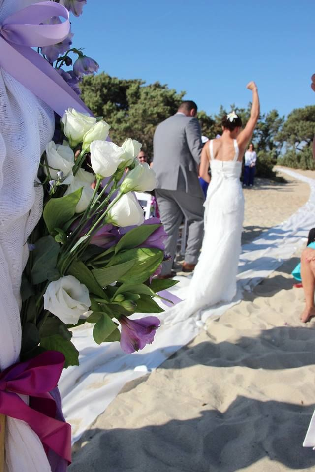 And they are off - Alyko beach destination wedding in purple - with a long white runner on the beach Naxos Greece #greeceweddings #islandeventsweddings #naxosislandweddings2015