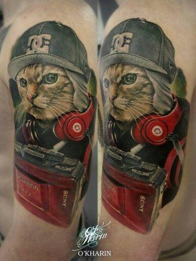 Aleksandr O'kharin cat tattoo