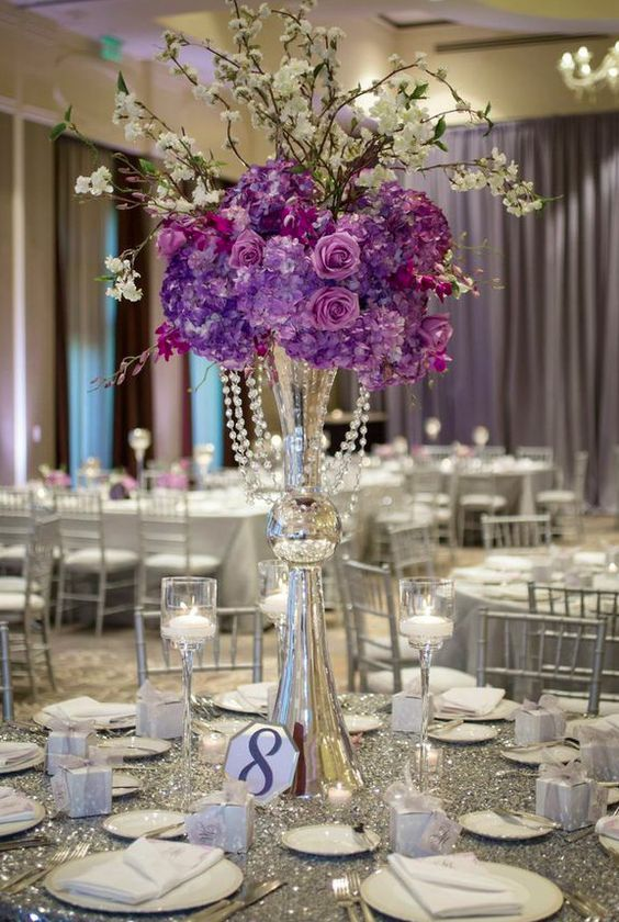 Featured Photographer: Janet Howard Studio; Wedding reception centerpiece idea.