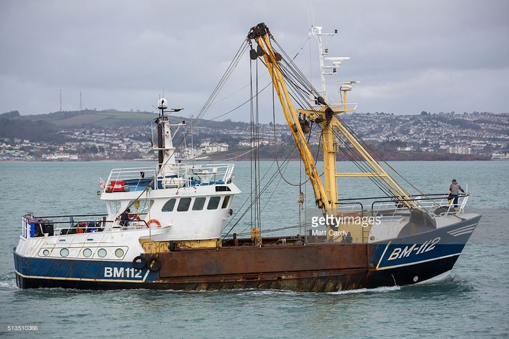The fishing trawler Sylvia T heads out to sea after being moored in Brixham harbour on March 3, 2016 in Devon, England. The UK's fishing industry is likely to be radically affected by the outcome of the EU referendum that the UK electorate will vote on June 23. Currently under the EU's Common Fisheries Policies (CFP), quotas are imposed on UK fishermen and it also grants equal access to other European fishing fleets to the UK 200-mile exclusive economic zone around the UK coastline whilst…