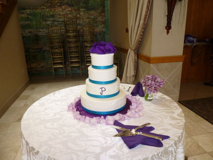 Purple wedding:  A purple lisianthus crown for this purple and teal wedding cake. Designed by WhimsicalWelcomes.com  Skippack, PA