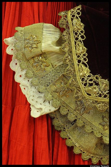 Closeup view of traditional Skopelos red gown @ The Folklore Museum of Skopelos