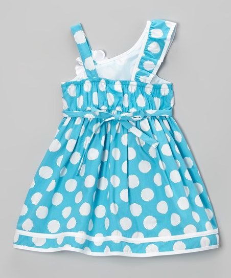 Any little lady will look and feel as fresh as a flower in this delightful dress thanks to its energetic pattern and fun, asymmetrical straps. Stretchy elastic in back allows for quick and easy changes.