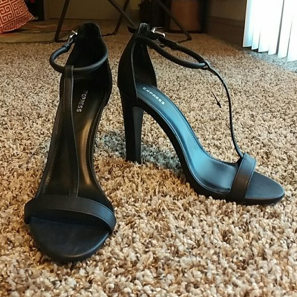 """NWOT Express heels Black Express heels. Strap across toes and an adjustable strap around ankle. Heel measures 4"""". Bought and took the tag off, but decided they were just a little too tall for me. Never worn. Express Shoes Heels"""