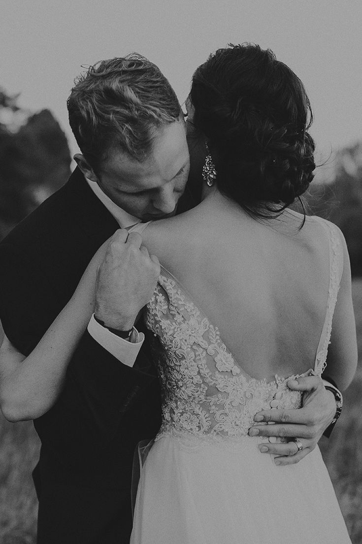 There's just something about this romantic moment between the bride and groom. It's so elegant yet quite sexy.