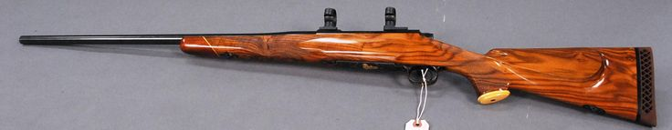 Winchester, model 70, 375 bolt action rifle with quality engraving and gold inlay having a high relief inlay of an elephant