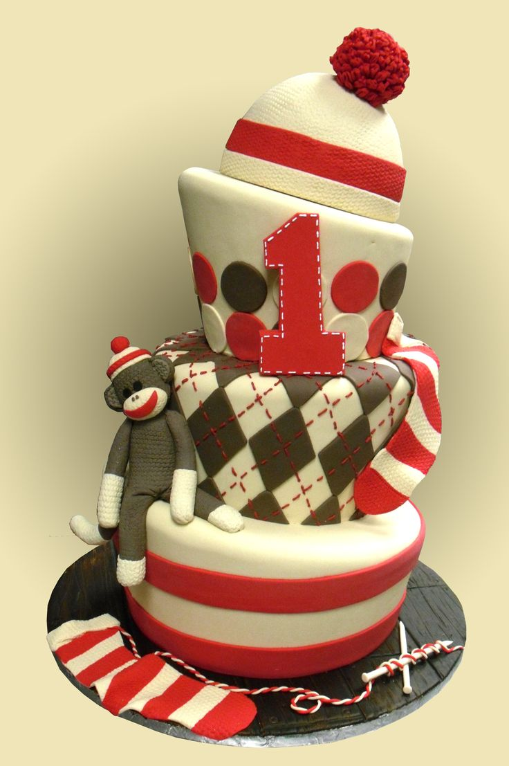 Sock monkey cake - You may have seen this cake around on Google images or others based off of mine I'm so glad that it could inspire others to get there sock monkey groove on, Ive had it on my website for a good long time now and i forgot that I never posted it, so here it is. All of the tiers are triples(6 inches high) except the hat. all are covered in fondant (satin Ice). I extruded the fondant to get the pom pom ball look, and used a knitted impression mat for he texture on the sock…