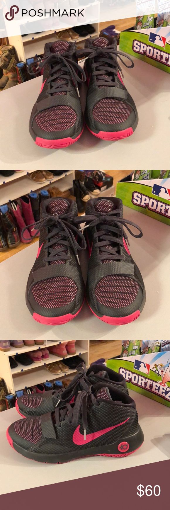 Nike 6 grey/pink Kevin Durant basketball shoes Nike 6 grey/pink Kevin Durant basketball shoes. These shoes have a grey netted look with pink details. There is also a Velcro grey strap at the bottom of the laces. They are gently used, but in great condition. Consigned to my boutique, no trades. Nike Shoes Athletic Shoes