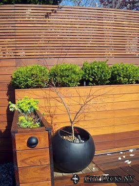 more variation in spacing on a horizontal fence - also, interesting idea of planters built up vs. hedges.