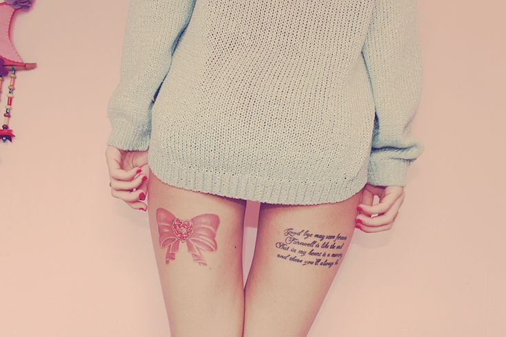 "Love the Pink Bow & the other tattoo is cute too it is a Fox & the Hound Quote ""Goodbye may seem forever. Farewell is like the end. But in my heart is a memory and there you'll always be."""