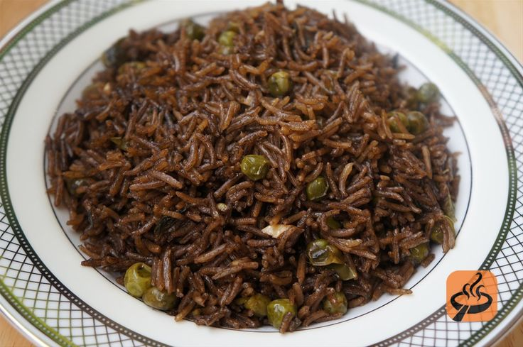 Black Mushroom Rice (Riz Djon-Djon) || long grain white rice, djon-djon (dried mushroom), baby lima beans (or green peas), garlic , thyme leaves, scallions, green peppers, black pepper, whole cloves, chicken bouillon powder