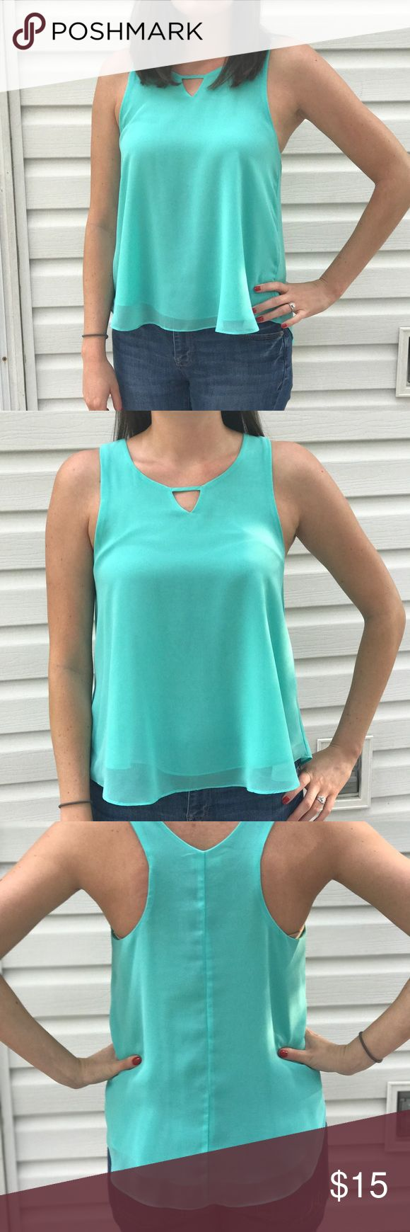 """BEAUTIFUL mint green flowy tank The color of this tank is to DIE FOR! Super comfortable and cute tank top, perfect for casual or dressy looks. Worn less than 5 times. Comes from a non-smoking and pet free home. LOVE this top, I just never wear it. I'm 5' 7"""" and 135 lbs. for size reference. 👗 e & m Tops Tank Tops"""