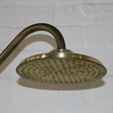 'natura' is the latin word for nature & offers a rustic feel to the #bathroom environment. When placed outside, it oxidises at a faster rate & transforms its colours into an original & unique scheme. This #brass #shower can be used as internal or outdoor shower   Please note: this will oxidise over time & will not remain its original colour, this is how it is meant to be & is why its so popular. #metalshower #showerrose #brassshower #bathroomideas #design #homedecor
