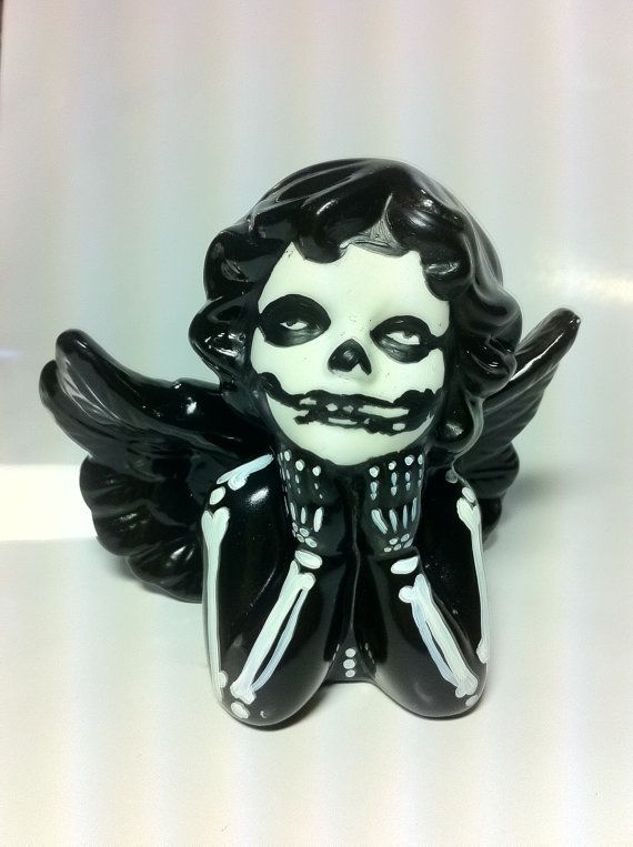 DIY - Paint a skeleton onto a Dollar store figure! Love this idea