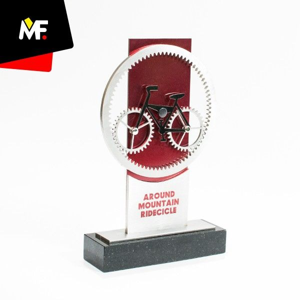 Trophy with an element in the form of a bicycle made of metal.