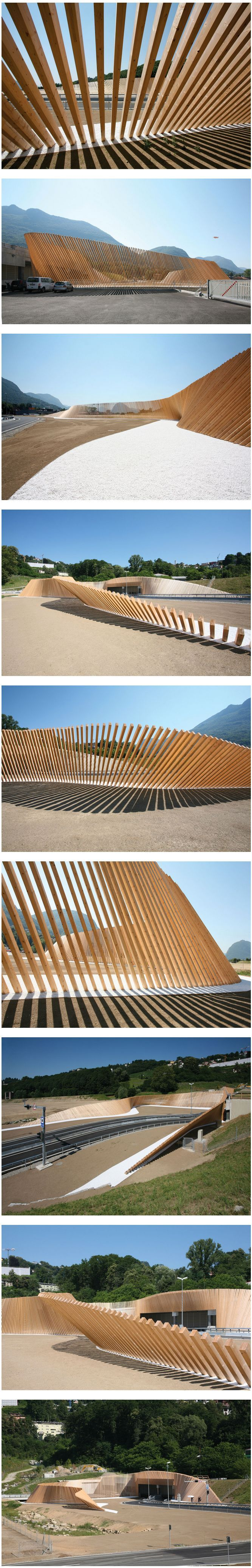 A large sinuous screen of wood designed by italian practice Cino Zucchi Architects defines a playful visual space at the entrance of the Vedeggio-Cassarate tunnel.