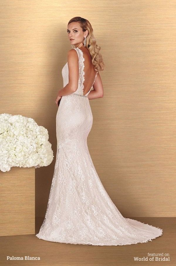 All lace gown with bateau neckline and plunging back. Sweetheart neckline on lining. Removable beaded belt at waist. Fit and flare skirt.