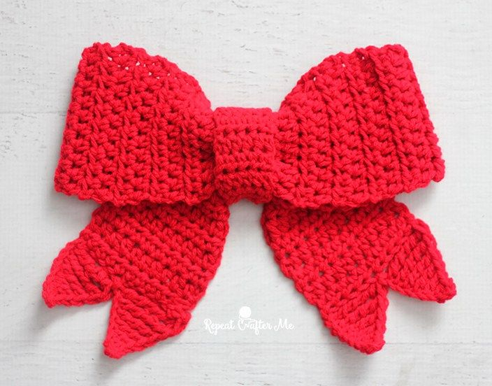 Big Red Bows make festive decor during the holiday season and now you can crochet one! Hang it on your door, wreath, tree, packages, and more! I've written out a simple pattern but included a little v