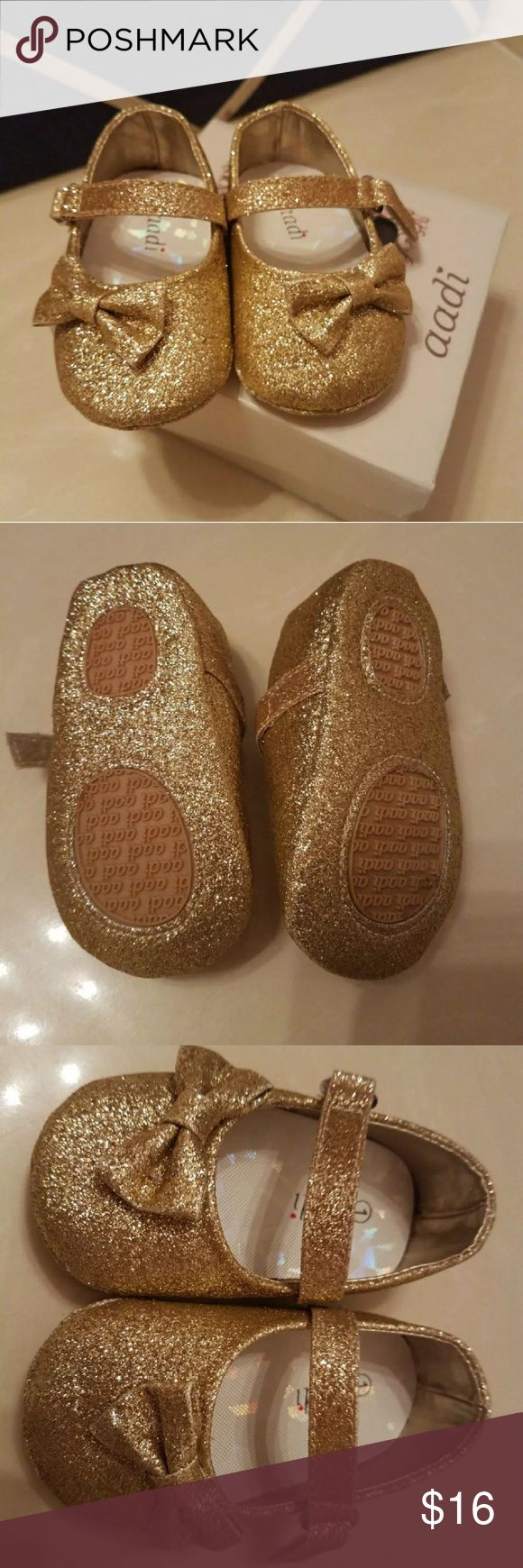 Babygirl Aadi Gold Glitter Dress Shoes Brand new! Very beautiful shoes can fit up to 3 Months. Perfect for the holidays or special occasions! Great for a gift. Check out my closet ❣ Shoes Dress Shoes