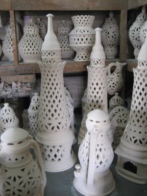Bahrain pottery. Potteries are still made in villages, particularly A'ali village which utilizes the mud from the nearby flats in Riffa. The pottery is made using a mixture of mud and water placed on a revolving wheel operated by an artisan. After the needed shape is obtained, the pottery is left outside to dry and harden.