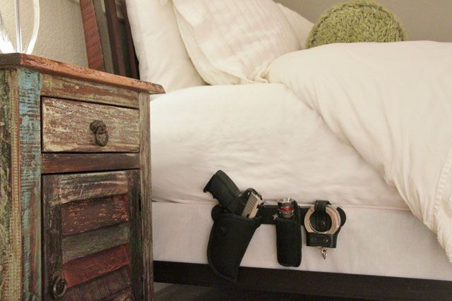 Wow! Hubby would like this.  Low profile piece of steel slides under mattress, bedding covers the gear. Gun holster, flashlight, pepper spray, handcuffs, etc. slides easily onto bar.  Found this at www.holstarr.com and it's made in here in the U.S.A.