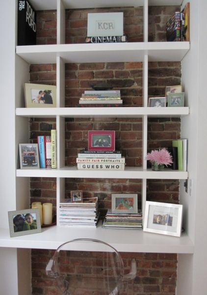 Open shelving with exposed brick wall