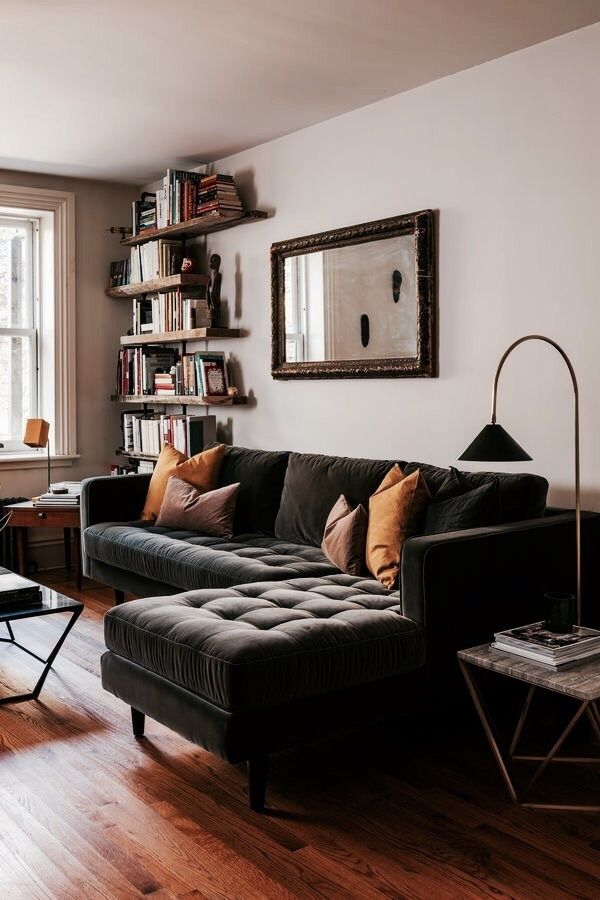 Velvet quilted sofa, marble top coffee and side tables, wooden shelves