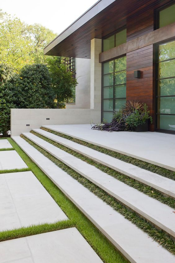 Facade of a Modern Home Featuring Floating Concrete Stairs Separated By Grass Strips | HGTV: