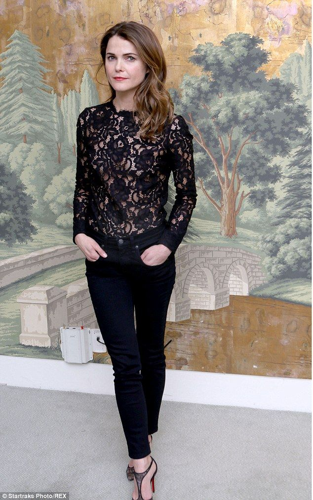 Keri Russell braves a potential wardrobe malfunction in a sheer lace top as she promotes her show the Americans