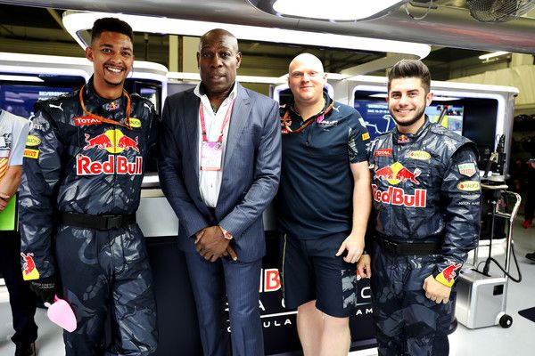 Frank Bruno Photos - Former boxer Frank Bruno with some Red Bull Racing mechanics in the Red Bull Racing garage before the Formula One Grand Prix of Great Britain at Silverstone on July 10, 2016 in Northampton, England. - F1 Grand Prix of Great Britain