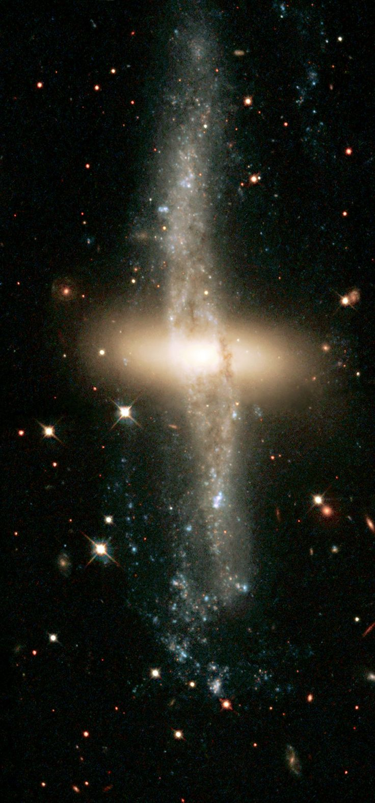 Located about 130 million light-years away, NGC 4650A is one of only 100 known polar-ring galaxies. - Credit: The Hubble Heritage Team (AURA/STScI/NASA/ESA)