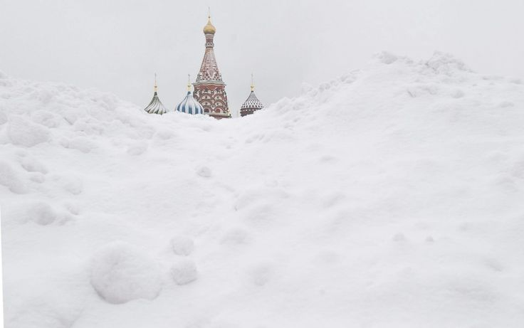 Saint Basil's Cathedral is seen behind snowdrifts in Moscow on December 5, 2012.    http://www.guardian.co.uk/news/gallery/2012/dec/05/24-hours-in-pictures#/?picture=400559936&index=9