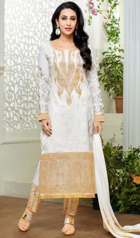 Allure the mass similar like Karisma Kapoor in this off white color georgette pant style suit. The ethnic lace and resham work in the attire adds a sign of magnificence statement for the look. #karismakapoordress #alluringdesigndresses #embroideredsuitsonline