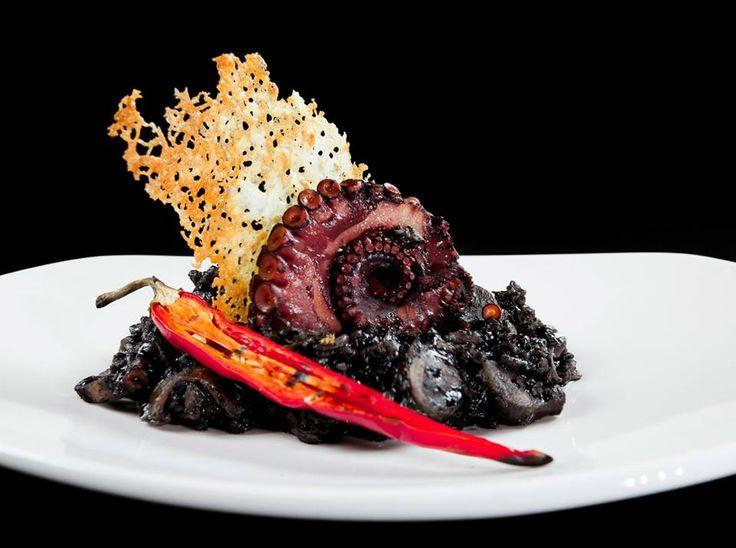 Risotto with cuttlefish, octopus, chili peppers, cuttlefish ink & Mediterranean herbs NU MODERN GREEK CUISINE CRETE PAPAROUNA WINE RESTAURANT & COCKTAIL BAR