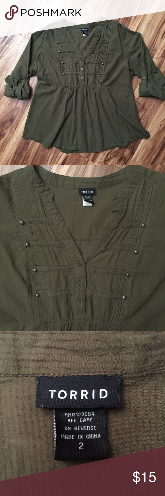Torrid Army Green Baby Doll 3/4 Button Top 2 XXL EUC Torrid top in a deep army green color. It is a size 2 (18/20) The sleeves roll up with a button closure and are full length when unrolled. The scrunched elastic back detail creates a flared out baby doll look, which is quite flattering! This too would be great with leggings and cute boots in the fall and shorts and gladiator sandals in the summer! Either way, this top is super on trend right now!  Keywords: military, army, green, khaki…