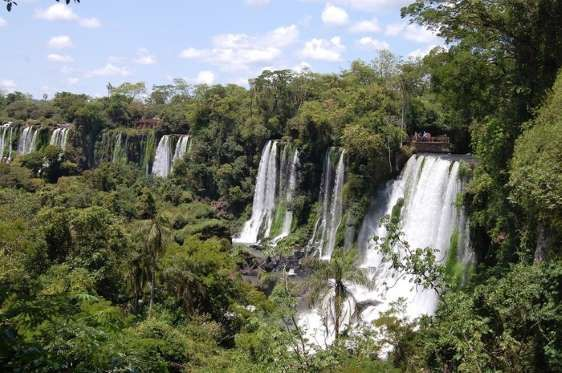 From 12 Must-See World Heritage Sites:  IGUAZU FALLS, ARGENTINA Also known as Iguassu Falls and the Iguacu Falls, this beautiful waterfall originates from the Iguazu River located on the border and forms a boundary between Argentina and Brazil. It is owned by two UNESCO World Heritage Sites, the Iguacu National Park in Brazil and the Iguazu National Park in Argentina. It is made up of 275 individual drops that stretch for 1.7 miles.