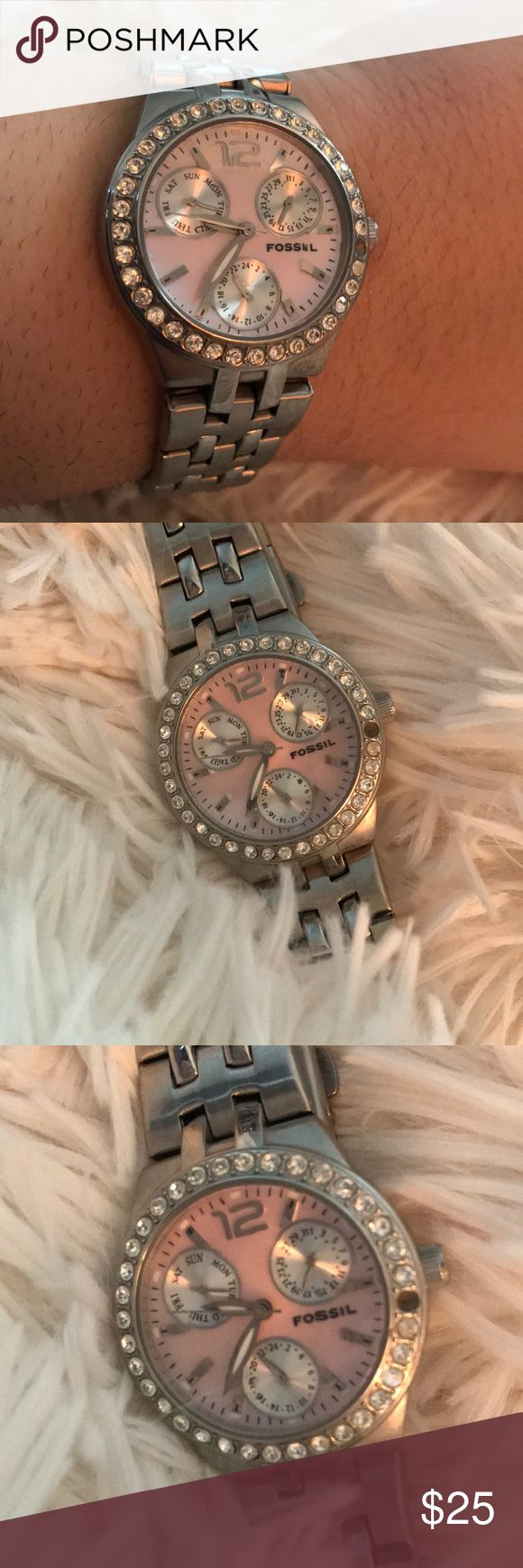 Women's Fossil Watch Used, Women's Fossil Watch. Battery is out, but should run perfectly when replaced. Pink face with a diamond shaped glass top. A stone is missing from around the face. Fossil Accessories Watches