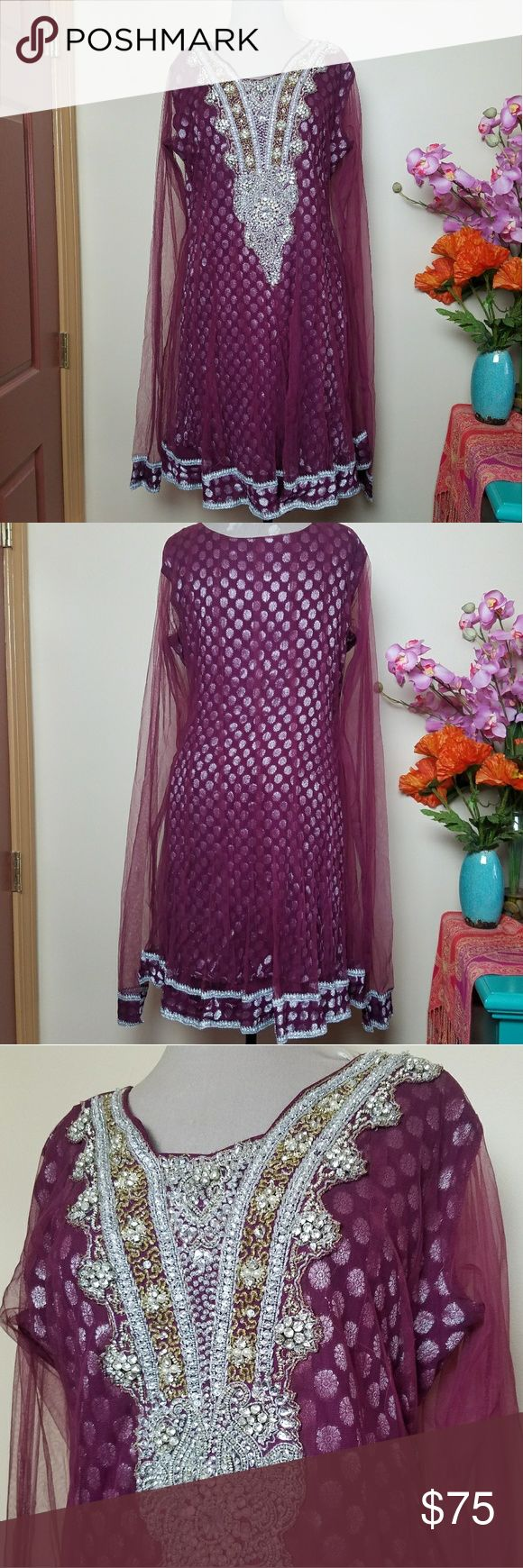 Burgundy Silver Handmade Indian Salwar Kameez Suit Stunning tunic dress and pant set! Lots of movement with extra long sheer sleeves to give a gathered effect when worn. Tons of rhinestone, sequin, and silver bullion embroidery embellishing the front. Sheer tulle above a layer of silver threaded fabric give a fun effect! Trimmed with crocheted bullion lace. Would fit a large or extra large. Pants are adjustable with drawstring. Handmade Dresses Mini