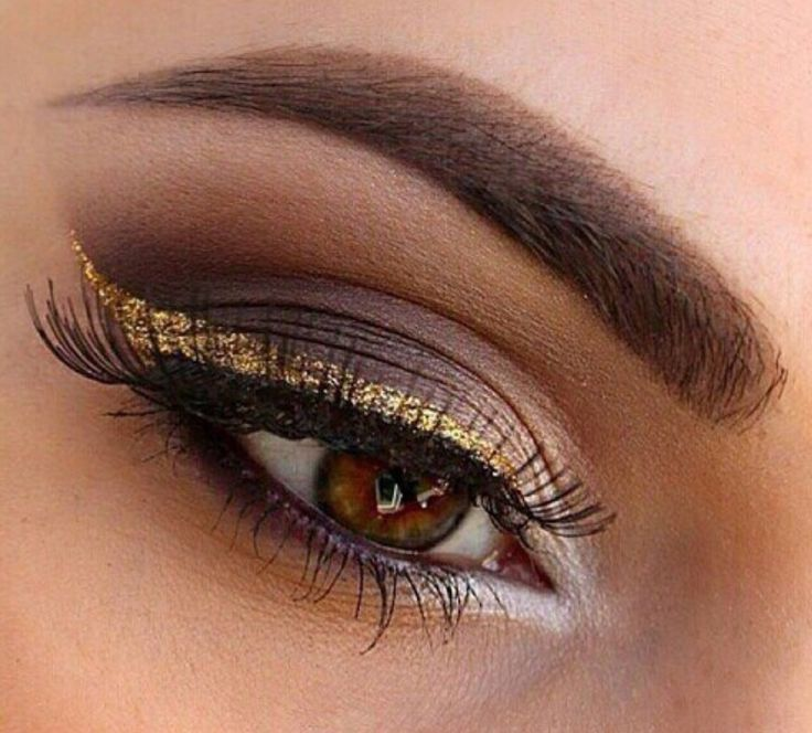 Gold eyeliner on top of a pretty dark matte eyeshadow! Love this idea!