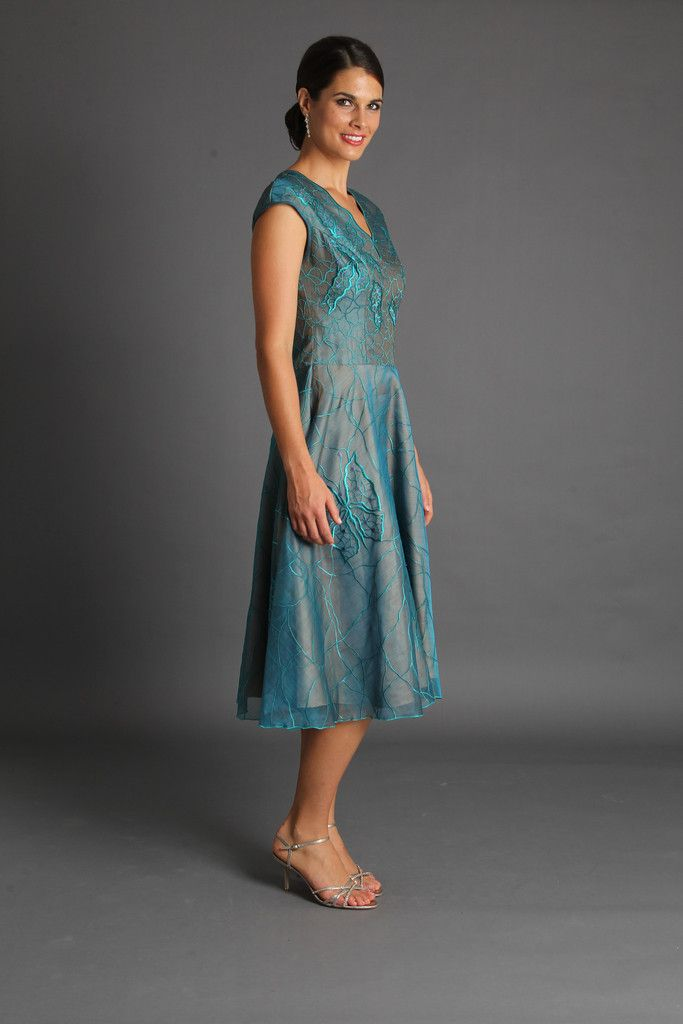 """Embroidered silk organza with a """"V"""" neck, cap sleeve, this is the perfect cocktail dress that will make you feel like a princess with the beautifully flared skirt that flows from the waist. Shown here in Turquoise. Available in a range of colours. For example, the video shows Rose. Sizing corresponds to Australian standard sizing as follows:XS: 6-8S: 8-10M: 10-12L: 12-14XL: 14-16"""
