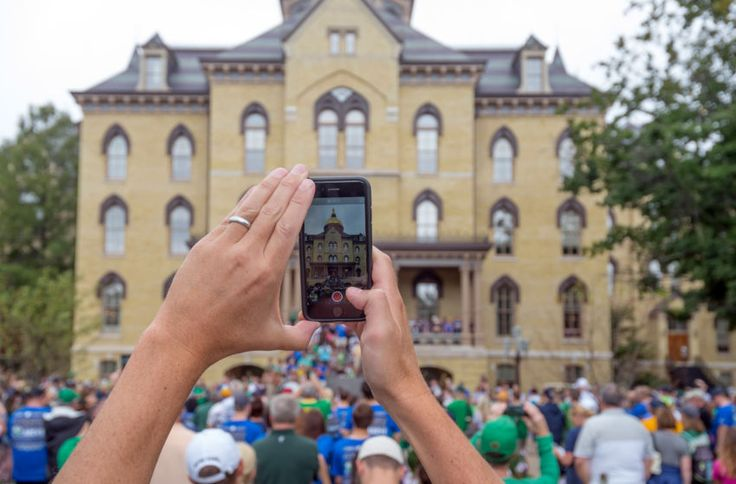 Sep 10, 2016; South Bend, IN, USA; A fan takes a photo of the golden dome on the administration building at the University of Notre Dame before the game between the Notre Dame Fighting Irish and the Nevada Wolf Pack at Notre Dame Stadium. Mandatory Credit: Matt Cashore-USA TODAY Sports