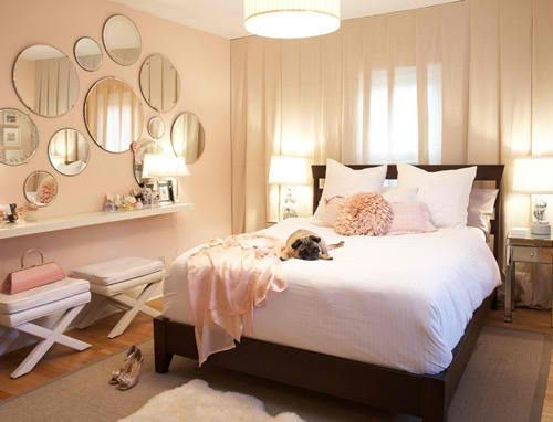 Bed against window. Then create dramatic wall art or design.