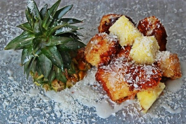 Deconstructed Pina Colada (pineapple chunks, soaked in rum, rolled in coconut, and deep fried)