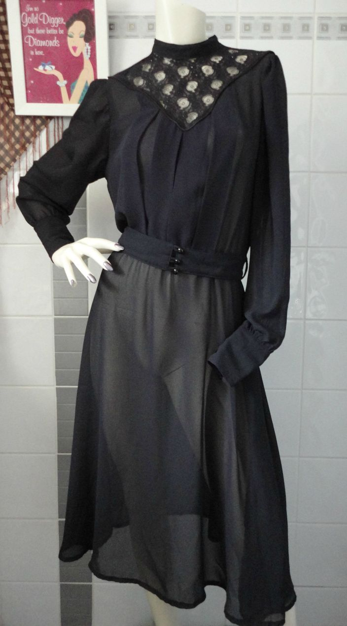 Rare Vintage 1980's Symbols, Black Chiffon Belted Dress Dark yet wickedly elegant black chiffon style dress with removable button-up fabric belt, pleated chest area & lace neck panel that buttons at the back. This item is in new condition for it's age.   Buy Now at TCC
