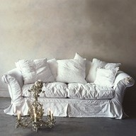 I love love love this sofa, it could be used against so many design pallets, but even here against a distressed wall it is beautiful....white isn't for everyone, but if it is slip covered with a cotton blend there is always OXYCLEAN and trust me it works, I've used it on hard stains for my IKEA white slip covers (but sadly and note to consumer they shrink no matter what after ONE wash, that is why you need a blend, mostly cotton but not 100% cotton)