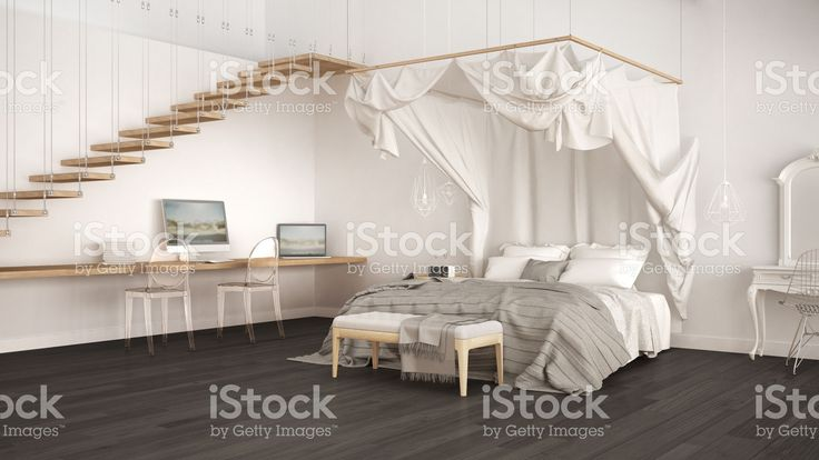 Canopy bed in minimalistic white and gray bedroom with home workplace, scandinavian classic interior design royalty-free stock photo