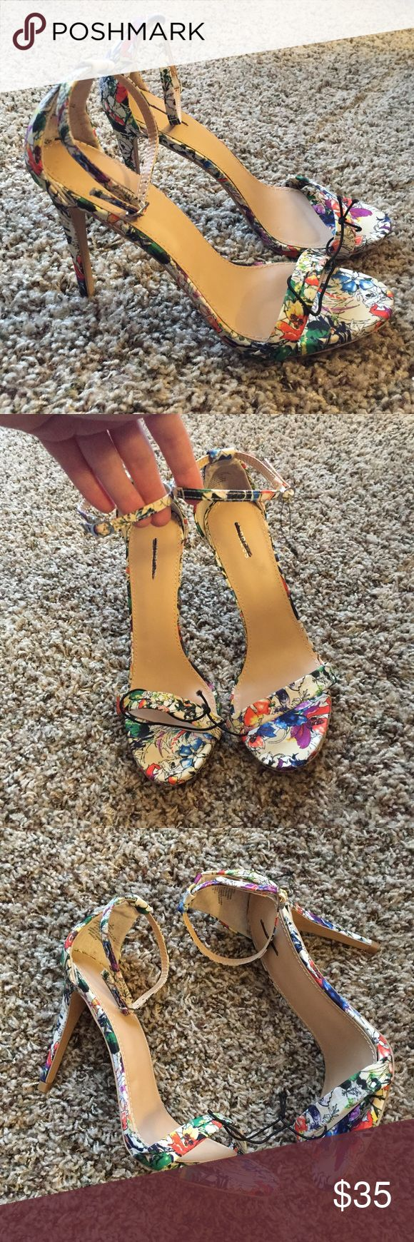 "NEW! Express Flower Strap Heel Sandals NEW! Express Flower Strap Heel Sandals in size 8. Beautiful flower print that will add a pop of color and spring to your outfit. Mlack strike through on inside sole over Express brand. 4"" heel. Express Shoes Sandals"