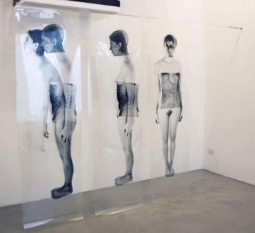 Giancarlo Marcali, Doppelgänger, avanzamento, 2012, Installazione, foto incisione su pellicola Agfa, cm 200x200x20